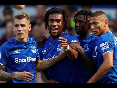 Everton's Alex Iwobi  celebrates after scoring his side's second goal