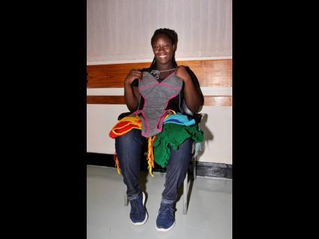 Shanice showcases her handmade swimwear.