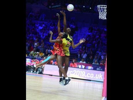 Jamaica's Jhaniele Fowler (right) challenges Lilian Ajio of Uganda for the ball during their Netball World Cup match at the M&S Bank Arena in Liverpool, England, on Thursday, July 18, 2019.