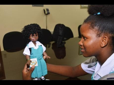 This Denbigh High student displays one of the dolls.