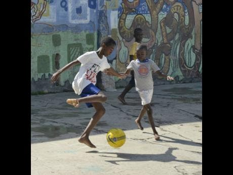 Life of Fleet Street is often joyful. Here there boys put their football skills on show.