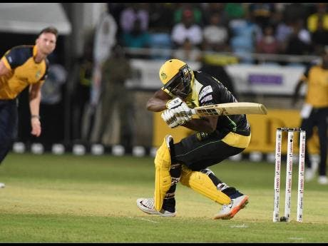 Jamaica Tallawahs batsman Andre Russell is floored by a short ball from St Lucia Zouks' Hardus Viljoen