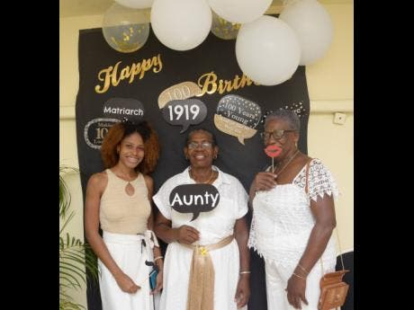 From left: Jamie Gibbs-Walters (great-grand niece), Cherry Mussington (niece) and Evelyn Palmer (niece) of centenarian Dorothy Austin pose for a photo ahead of birthday celebrations at the Medallion Hall Hotel.