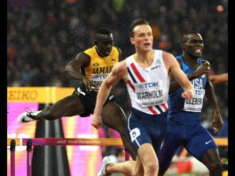 File  Kemar Mowatt (left) clears the final hurdle in the men's 400m hurdles final at the London World Championships as Norway's Karsten Warholm (second right),  runs home to claim his first global title in 48.35 seconds. USA's Kerron Clement was third in 48.52.