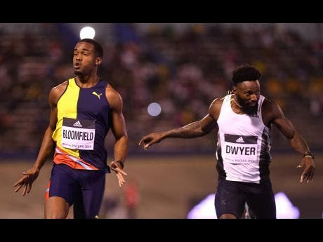 Bloomfield celebrates after winning the the men's 200m ahead of Rasheed Dwyer at the 2019 Racers Grand Prix.