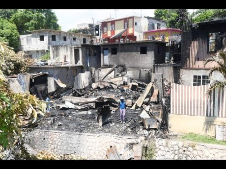 Fire of unknown origin destroyed this dwelling at  Air Pipe Lane, near Liguanea, in St Andrew on Sunday night.