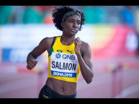 Shiann Salmon on her way to a personal best time of 55.20 seconds in the women's 400m hurdles event at the IAAF World Championships at the Khalifa International Stadium in Doha, Qatar, yesterday.