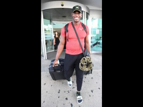 Discus throw silver medallist Fedrick Dacres  on arrival at the Norman Manley Ineternational Airport from the IAAF World Championships held in Doha, Qatar.