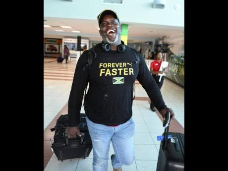 Throws coach Julian Robinson  on arrival at the Norman Manley Ineternational Airport from the IAAF World Championships held in Doha, Qatar.