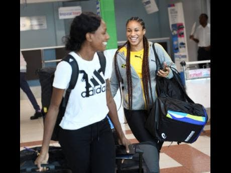 Rhonda Whyte  with Briana Williams  on arrival at the Norman Manley Ineternational Airport  yesterday from the IAAF World Championships held in Doha, Qatar.