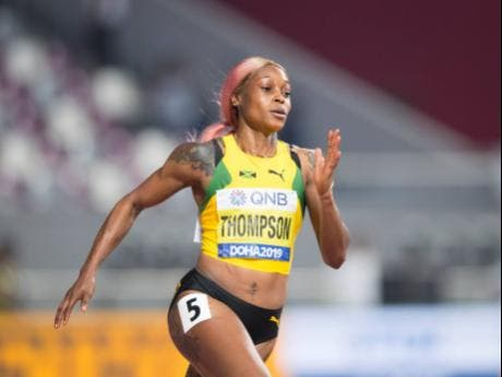 Elaine Thompson competing in her heat of the women's 200m at IAAF World Athletics Championships. Thompson would later pull out of the  semis citing  injury.