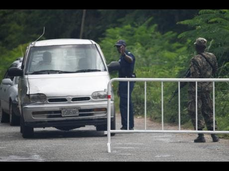 Jamaica Defence Force and police personnel conduct operations in Sevens Heights, Clarendon.