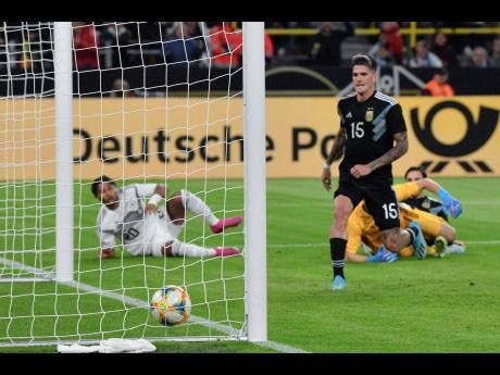 Germany's Serge Gnabry (left) scores his side's first goal past Argentina's goalkeeper Agustin Marchesin during the international friendly between Germany and Argentina yesterday.