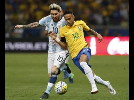 Argentina's Lionel Messi (left) and Brazil's Neymar fight for the ball during a World Cup qualifying  match between Brazil and Argentina in  2016.