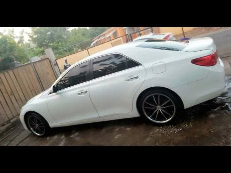 This white 2011 Mark X was reportedly stolen from DJ Ruxie's Kingston residence last week.