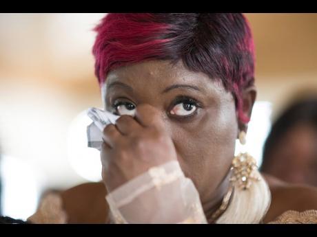 Danike Bailey wipes away her tears.