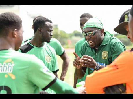 Coach of Calabar High School David Lalor (right) delivers a team talk ahead of their ISSA/ Digicel Manning Cup match against Norman Manley High on October 9.
