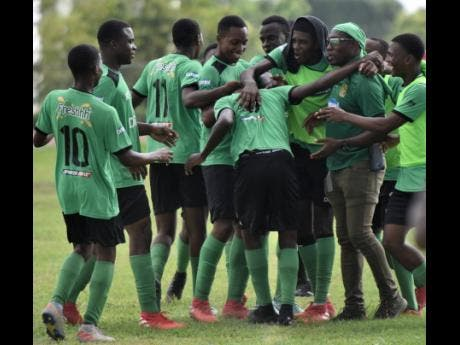 Members of Calabar High's team celebrate after scoring a goal against Norman Manley High during their ISSA/Digicel Manning Cup match at Calabar last Wednesday.