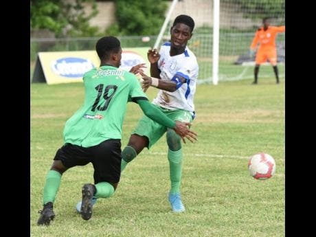 Latrae Harris (right) of Norman Manley High and Calabar High's Tyrease Thompson in a keen tussle for the ball during their ISSA/Digicel Manning Cup match at Calabar on Wednesday October 9.. Calabar were leading 2-1 when the match was abandoned due to rain and lightning.
