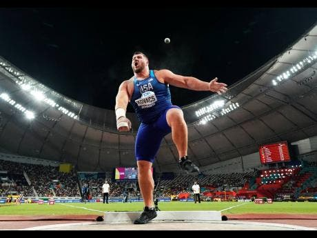 Joe Kovacs, of the United States, competes in the men's shot put final to win the championship record for gold at the World Athletics Championships in Doha, Qatar, October. 5, 2019.