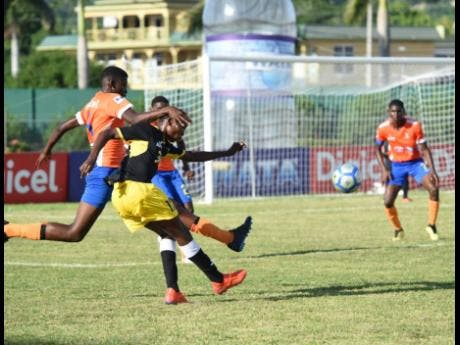 Lennon High's Gowain Austin (left) tackles the ball from his opponent Clarendon College's Kodrick Granville (right) during the ISSA/WATA daCosta Cup match at the Montego Bay Sports Complex on September 7.