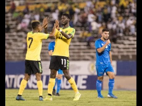 Jamaican striker Shamar Nicholson (right) celebrates after scoring against Aruba in the Concacaf Nations League match at the National Stadium in Kingston, Jamaica, on Sunday October 13, 2019.