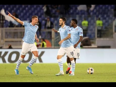 Lazio's Sergej Milinkovic-Savic (left) celebrates after scoring his side's first goal during their Europa League Group E match against Rennes, at Rome's Olympic Stadium on Thursday, October 3.