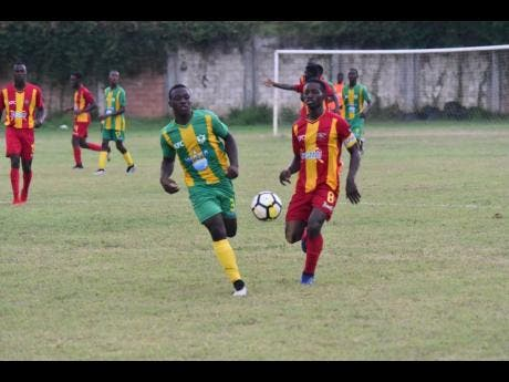 Cornwall College's Solano Birch (right) battles Green Pond High School's Zedford Vacciana in Group A action of the ISSA/WATA DaCosta Cup at Cornwall College's football field on September 11.