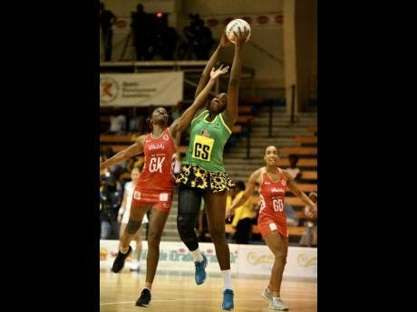 England's goalkeeper Ama Agbeze (left) tries her best to intercept a pass to Jamaica's Jhaniele Fowler, while goal defence Layla Guscoth looks on during the third and final Lasco Sunshine Series game between Jamaica and England at the National Indoor Sports Centre on October 15, 2018.