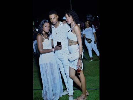Shay (left) Chris and Sabena adhere to the all-white dress code.