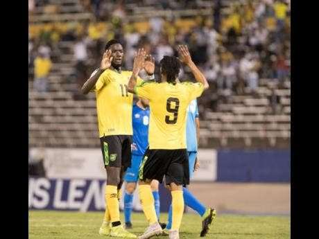 Shamar Nicholson (right) celebrates with his teammates after scoring against Aruba in the Concacaf Nations League at the National Stadium in Kingston on October 13, 2019.