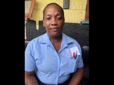 Racquel Reid on duty at a funeral home in Kingston.