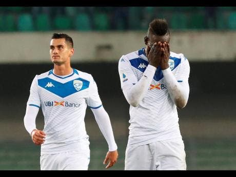 Brescia's Mario Balotelli (right) reacts at the end of the Italian Serie A match against Verona at the Bentegodi stadium in Verona on November 3.