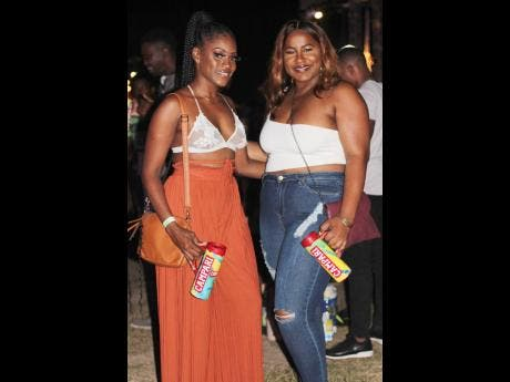 Glam Plus Fun's owner Trycelle Bailey and her party pal Omeisha Smith were just two of the many satisfied females that turned out to 36 Hope Road to get a view of Xodus Carnival's Enchanted costumes.