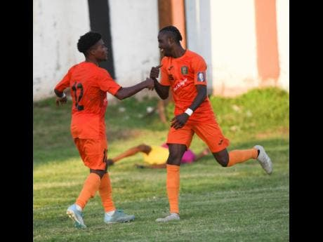 Tivoli Gardens'  Howard Morris (left) celebrates with Davion Garrison, who scores to beat Dunbeholden 1-0 in their Red Stripe Premier League encounter at the Edward Seaga Sports Complex on Sunday, October 20, 2019.