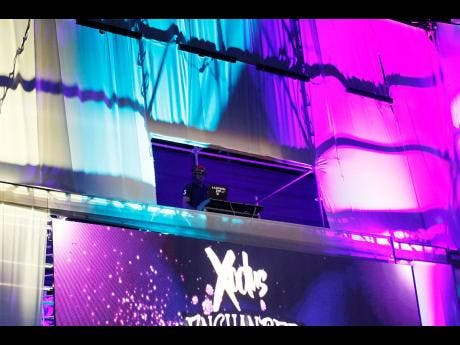 DJ Lantern MD high above in Xodus Carnival's flying music booth.