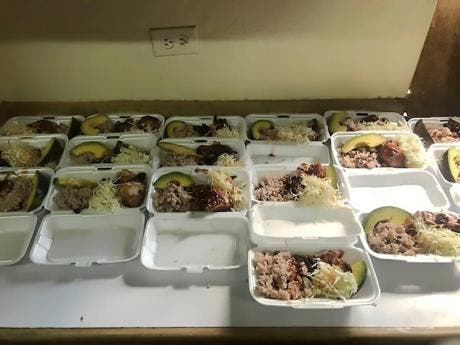 Boxes of food waiting to be delivered.