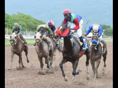 SUPERLUMINAL (second right), ridden by Omar Walker, finishes ahead of BRUCE WAYNE and DONTAE to take the Fontainbleu Trophy at Caymanas Park on Saturday, October 19, 2019.