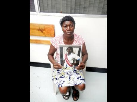 Carlene Bennett-Clarke with a photo of her daughter