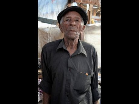 Gladstone Taylor, 85, at his stall at Ray Ray Market on West Queen Street.