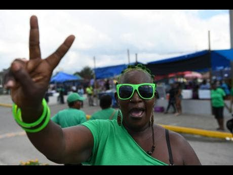 Joan Williams, a rockstone labourite from Tivoli Gardens in West Kingston, flashes the party's victory symbol at last year's  annual conference.