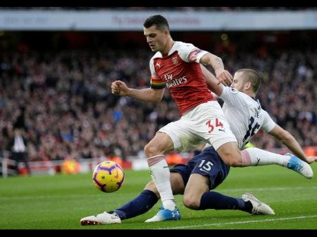 In this Sunday, December  2, 2018 file photo, Arsenal's Granit Xhaka (left) fights for the ball with Tottenham's Eric Dier during their English Premier League match at the Emirates Stadium in London.