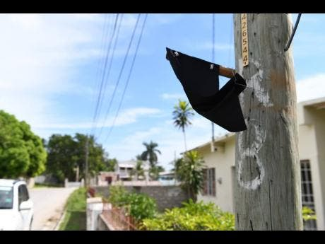 A piece of black cloth hangs from a lightpost in memory of Abigale Rowe.