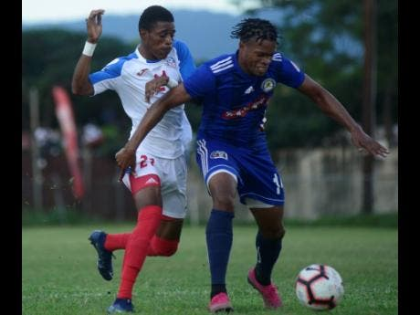 Mount Pleasant's SueLae McCalla (right) shields the ball from Portmore United attacker Courtney Allen in their RSPL encounter at the Spanish Town Oval on Sunday, November 24, 2019.