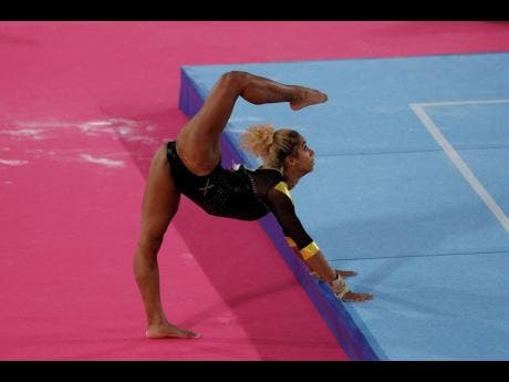 Jamaica's Danusia Francis stretches before competing on floor in the women's gymnastics qualification and team final at the Pan Am Games in Lima, Peru,  on July 27, 2019.