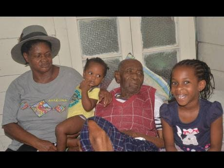 Surrounded by family members, Charles Edward James, also called Maas Tata, fathered 10 children and has more than 100 grandchildren and great-grandchildren.