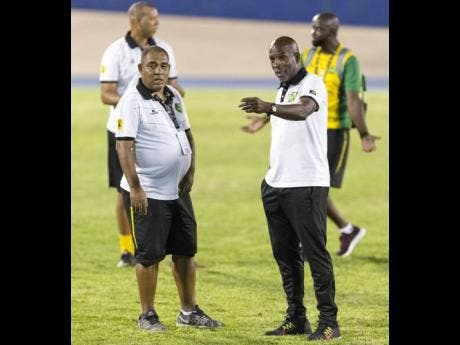 Hue Menzies (left) and Lorne Donaldson talks before the Reggae Girlz take on Antigua in a World Cup qualifier at the National Stadium on August 25, 2018.