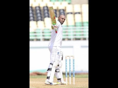 """File photos left: Windies 'A' batsman Sunil Ambris hails applause for his hundred against Sri Lanka 'A' on the second day of the first """"Test""""  at the Trelawny Multipurpose Stadium in October 2017."""