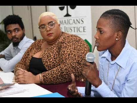 Former ward at Armadale Juvenile Correctional Centre Moya Blackwood (right) addresses the Jamaicans For Justice (JFJ) press conference yesterday. Looking on are (from left) Rodje Malcolm, JFJ's executive director, and Monique Long, the entity's policy advocacy manager.