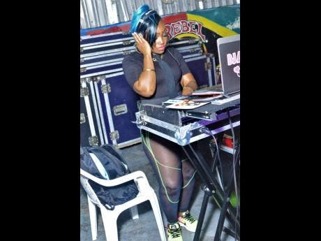 DJ Lady Michelle on the consoles.